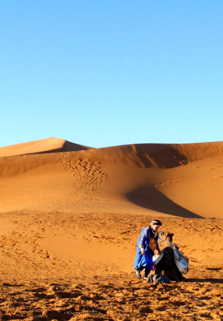 Berber tending to camel