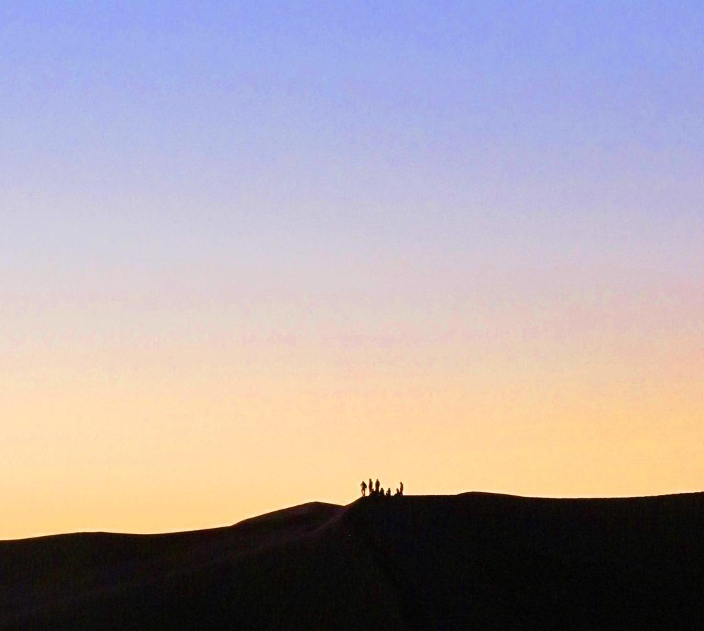 People on Sahara dunes
